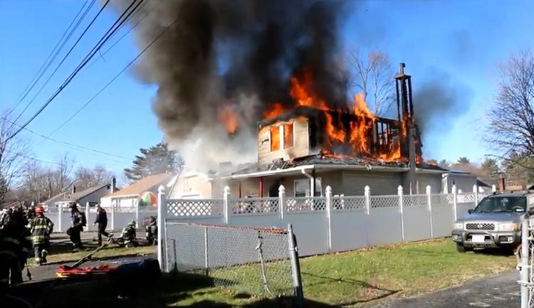 Burning house at daytime