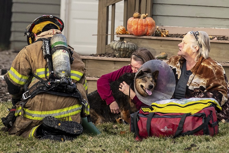 Omaha firefighters battle a fire after an explosion leveled a home in a south-central Omaha neighborhood on Tuesday, Dec. 8, 2020, in Omaha, Neb., damaging nearby homes and leading to at least one person being injured. (Chris Machian/Omaha World-Herald via AP)
